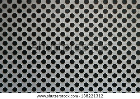Metal net circle texture background networks with holes - stock photo