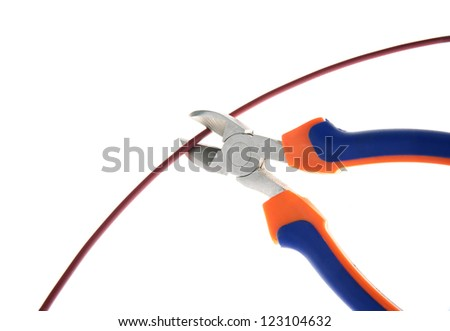 Metal nippers is cutting red cable on white background