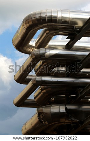 metal oil pipe in refinery under sky - stock photo