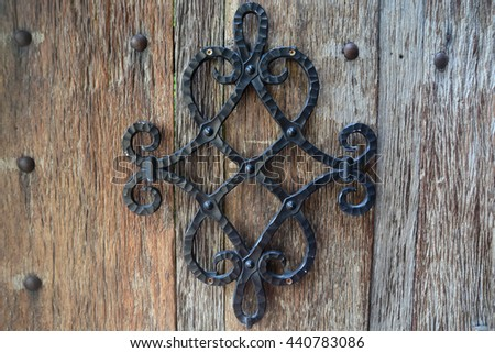 Metal ornament on a wooden planks - stock photo