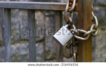 Metal padlock and chain - stock photo