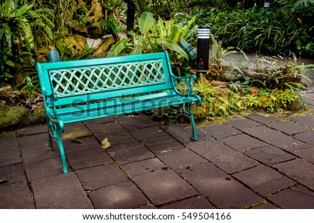 metal park bench on concrete floor in the garden - Garden Furniture Metal