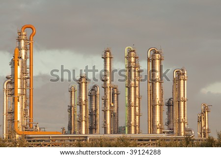 metal pipelines petrochemical industry with a nice glow of the morning sun oil technology petroleum factory - stock photo