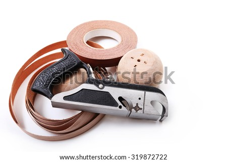 Metal plane, beech wood products and furniture edges - stock photo