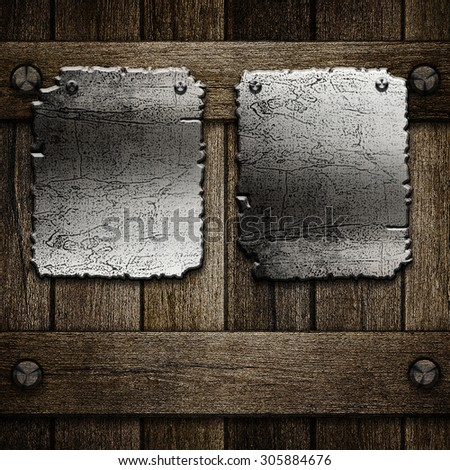 Metal plate on old wooden background for design