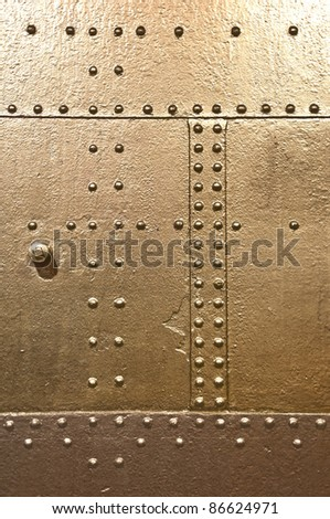 metal plate, rivets - stock photo
