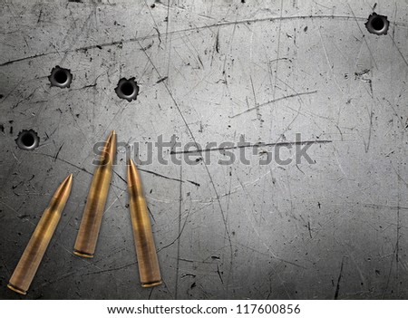 Metal plate with bullet holes - stock photo