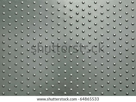 metal plate with dot pattern - stock photo