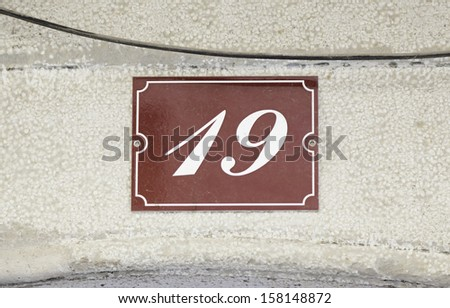 Metal plate with the number nineteen, detail of a data plate with a number - stock photo