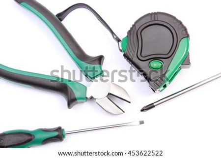 Metal pliers, electrical screwdrivers and tape measure on white background, work tools and accessories for engineering jobs - stock photo