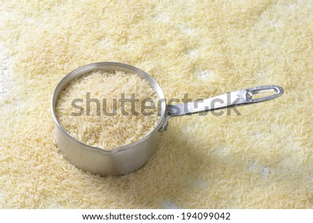 metal pot filled with jasmine rice - stock photo
