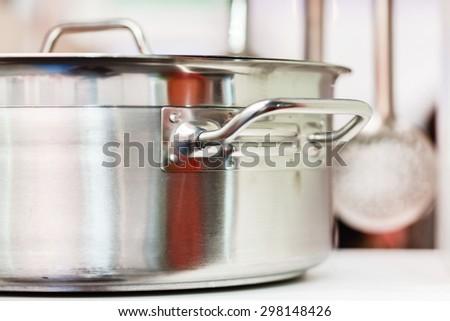 metal pot on the kitchen  - stock photo
