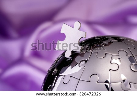 Metal puzzle globe isolated on white background  - stock photo