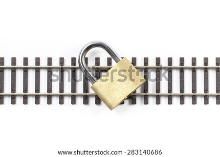 Metal railway tracks with locked padlock on them, isolated on white background. The image symbolizes a closed railway road. - stock photo