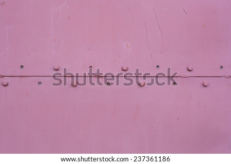 metal rivets on the wall - stock photo