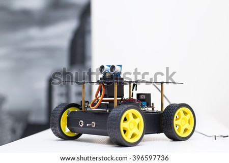 metal robot with wheels stands sideways