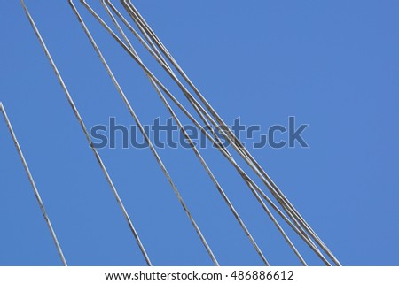 metal rods with blue sky in background