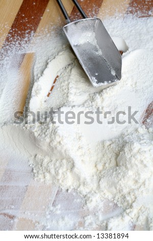 Metal scoop and flour, background