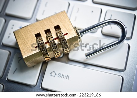 metal security lock with password on computer keyboard - security concept in computer - stock photo