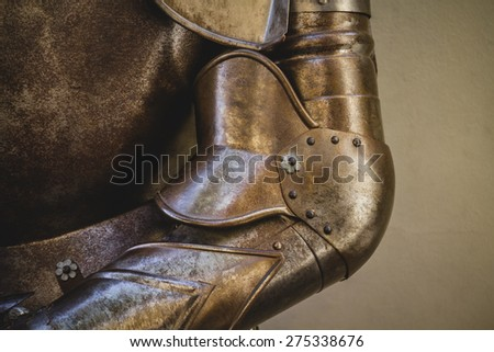 metal shield, medieval armor made of wrought iron - stock photo
