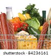 metal shopping trolley with different product - stock photo