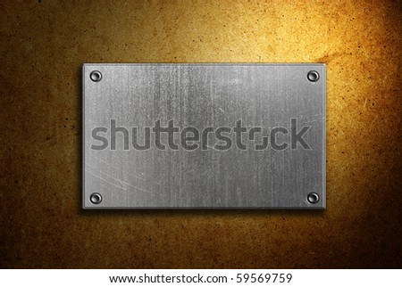 metal sign on plywood background - stock photo