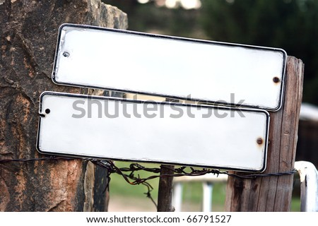 Metal signs on gate of farm, no words - stock photo