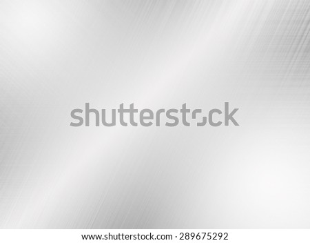 Metal silver background or texture of brushed steel plate with reflections - stock photo