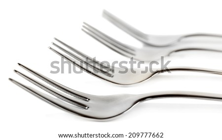 Metal small dessert forks isolated on white - stock photo