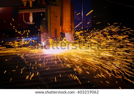 Metal sparks. Industrial laser and plasma cutting of sheet steel.