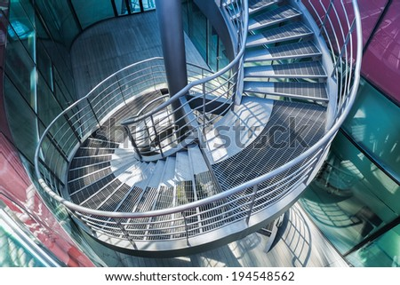metal spiral staircase in  modern building ,upside view  - stock photo