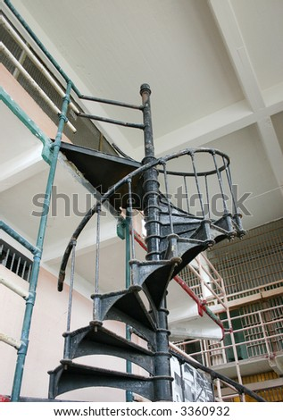 metal spiral stairway in library of Alcatraz prison