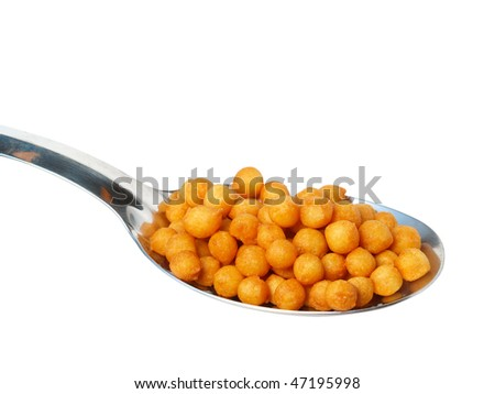Metal spoon with croutons isolated on white background - stock photo