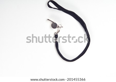 Metal sport coaches whistle with lanyard isolated on a white background with copy space - stock photo