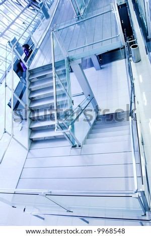 metal stairs and panaramic view of hall
