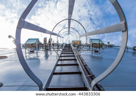 Metal stairway to top of battle ship - stock photo