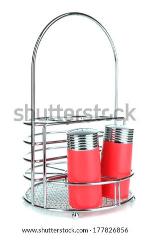 Metal stand for cutlery with salt and pepper grinders isolated on white