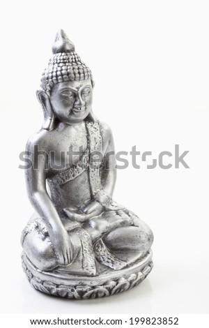 Metal statue of Buddha, close up - stock photo