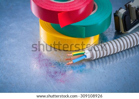 Metal strippers conduct tubing wires and insulating tape. - stock photo
