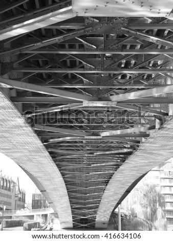 Metal structure under a bridge