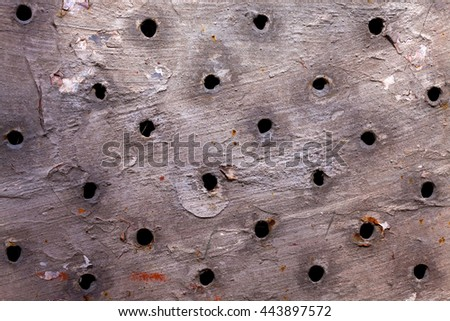 Metal surface rusted and corroded perforated iron plate on metallized background