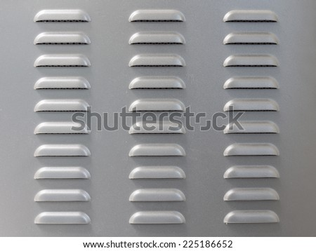 Metal surface with air vent perforation - stock photo