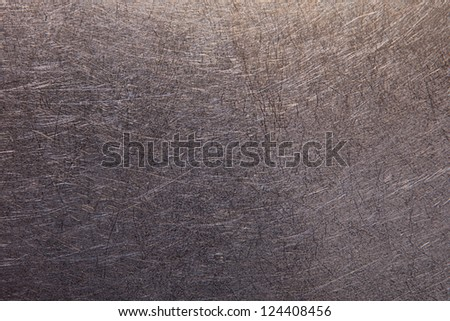 Metal surface with scratches closeup - stock photo