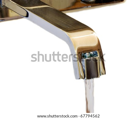Metal tap with stream of water - stock photo