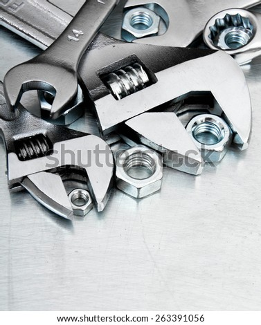Metal tools. Metal style. Wrenches and nuts on the scratched metal background. - stock photo