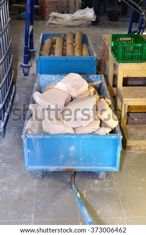 Metal trolley with soap and indoor plant for the production of soap - stock photo