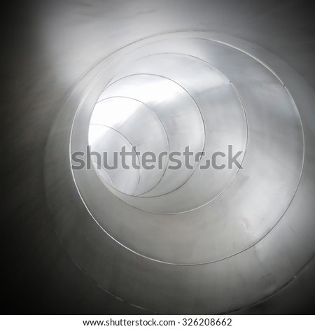 Metal tube  industrial background metal shining tube - stock photo