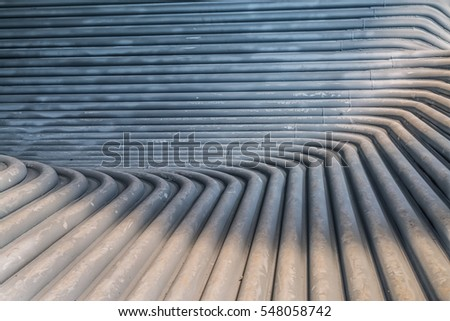 Metal tunnel made of rounded steel pipes.