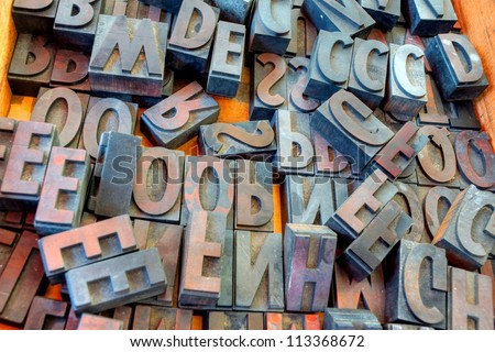 metal vintage letterpress printing blocks - stock photo