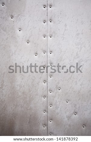 Metal wall texture, detail of a wall with rivets metal background with texture - stock photo